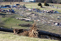Volunteers comb through the debris of homes where several people died in tornado destruction in East Bernstadt, Kentucky,