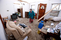 Carolyn Taulbee sifts through her belongings left from the tornado destruction in East Bernstadt, Kentucky