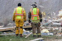 Snow falls as Laurel County Fire Dept Chief Tommy Johnston and Lt Trevor Allen perform a secondary survey of the tornado damage in East Bernstadt, Kentucky